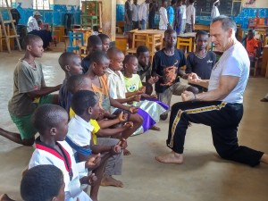 Africa kids make a tkd fist with Master Dean